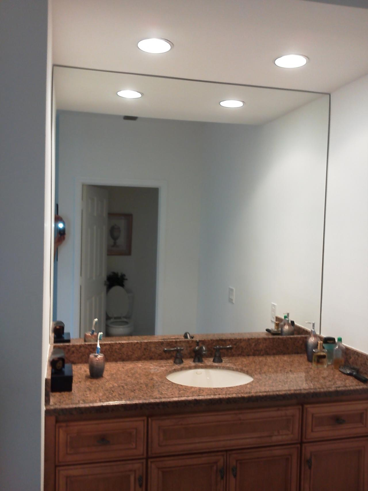 Looking glass company mirror installation create the illusion of a larger space in a small room with a full wall of mirrors amipublicfo Choice Image
